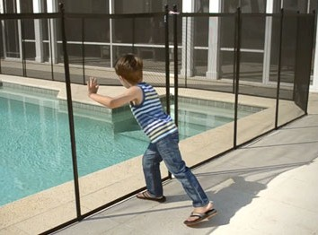 Boy Pushing Pool Fence