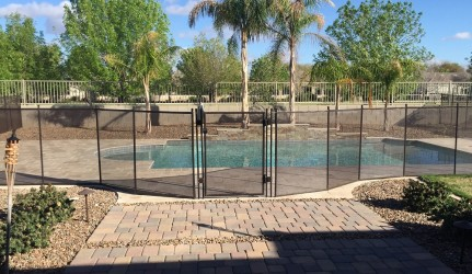 Pool Fence with a Self-Closing Gate