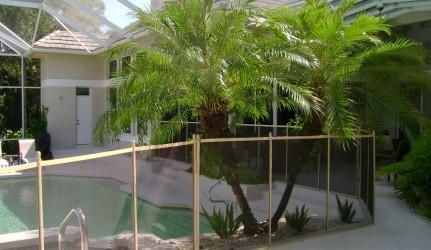 Tan and Brown Pool Fence