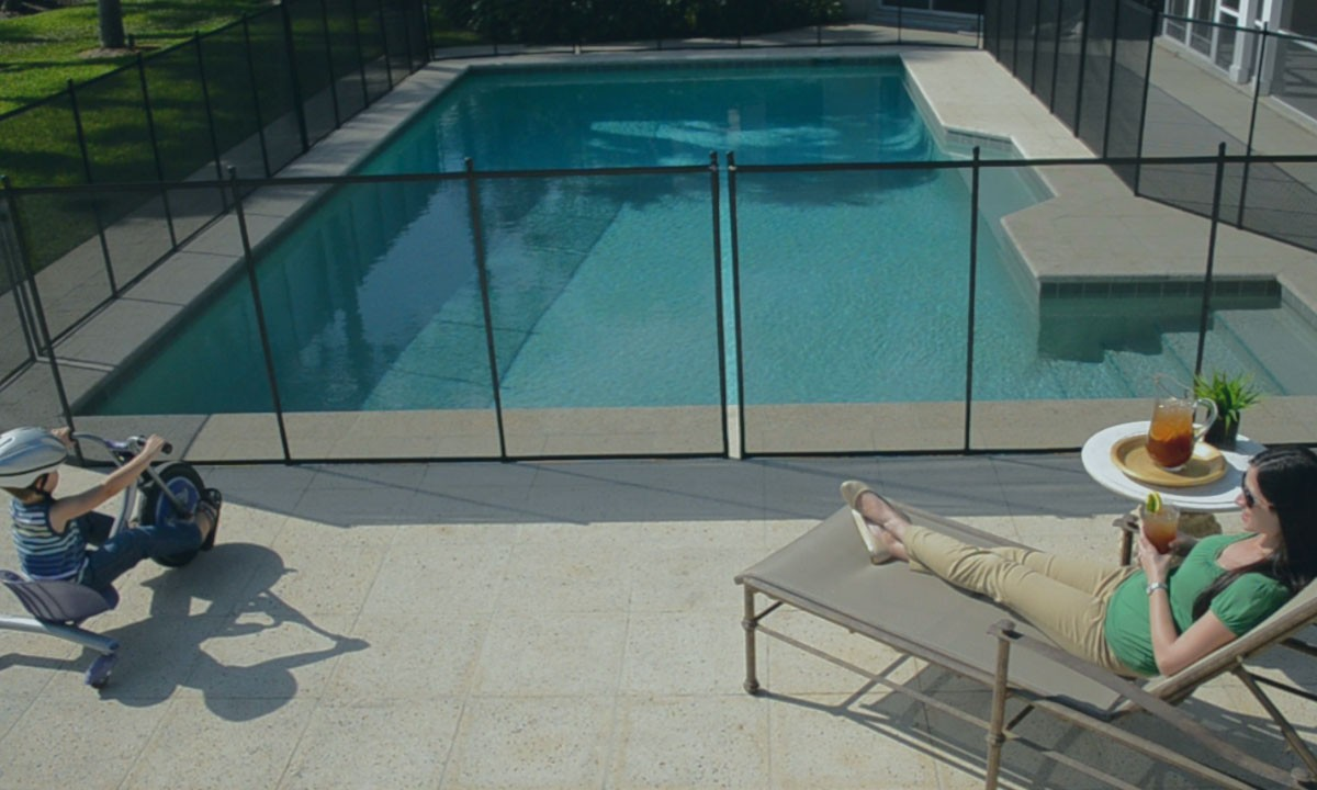Protect a child pool fence start enjoying your pool patio for Pool design education