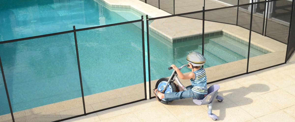 Boy Bikes into Pool Fence