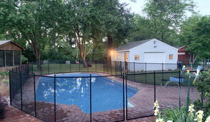 black curvy pool fence